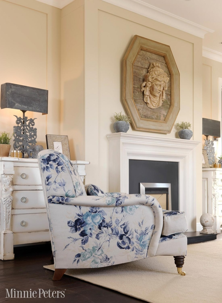 Cream and white color living room; chair; fireplace; lamp | Interior Designer: Minnie Peters
