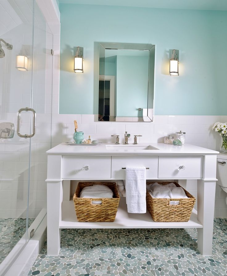 Bathroom sconce, sink, mirror, backsplash, lighting, decor, cabinet, design; turquoise | Interior Designer: Carla Aston