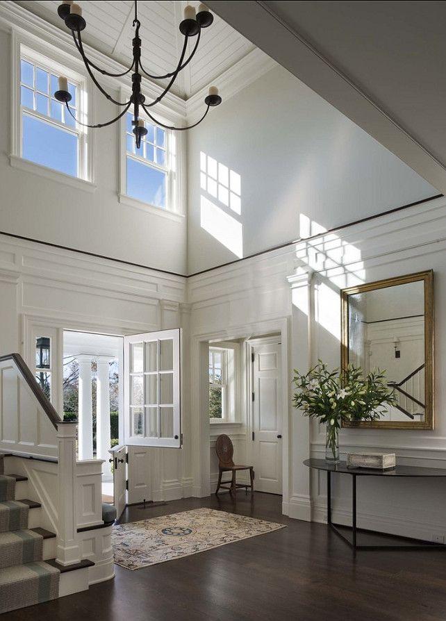 Wood floor / flooring; vista; entryway; mirror; stairway| Interior designer: Victoria Hagan / Image source: Home Bunch