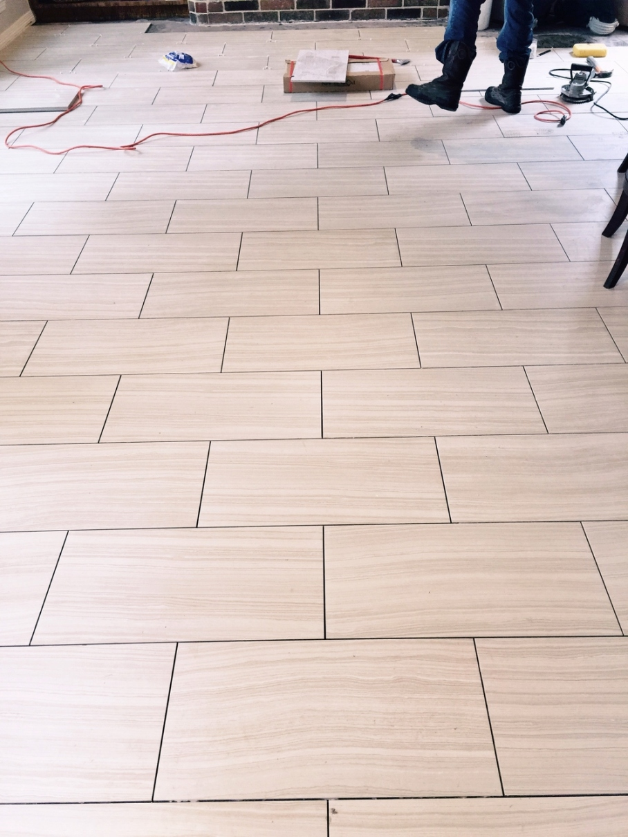 Floor tile being laid.jpg