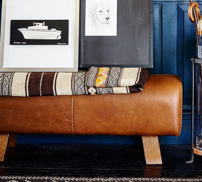 Ken Fulk leather pommel bench; framed art | Image source:Pottery Barn