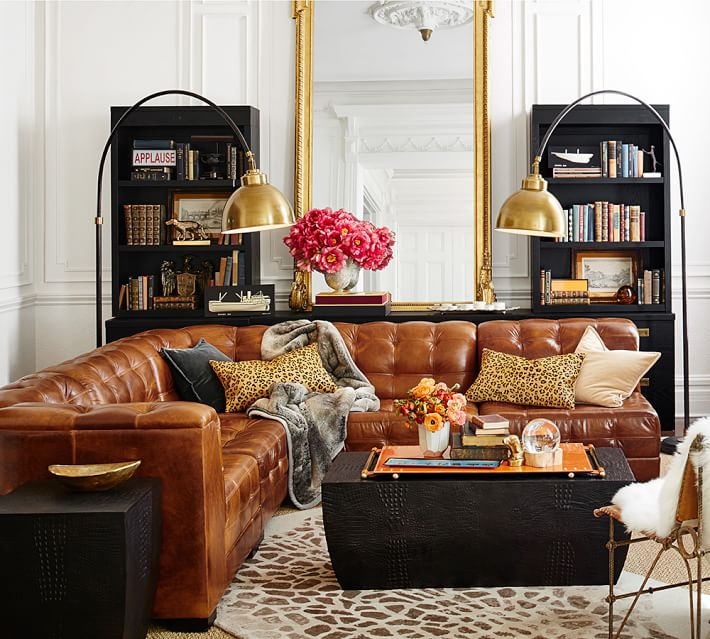 Ken Fulk quilted leather sectional; couch / sofa; living room; lamp / lighting; bookshelf | Image source: Pottery Barn