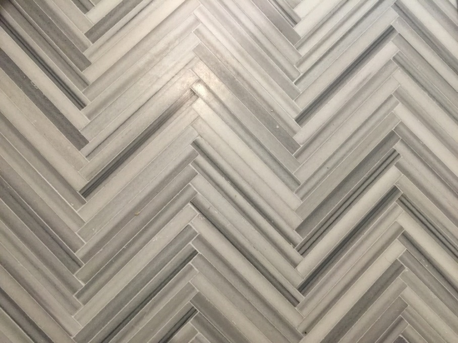 Herringbone marble floor from Habitat Stone in Houston