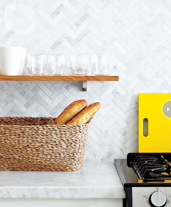 Kitchen; counter; herringbone pattern backsplash; stove| Interior Designer: Samantha Sacks / Image source: Style at Home