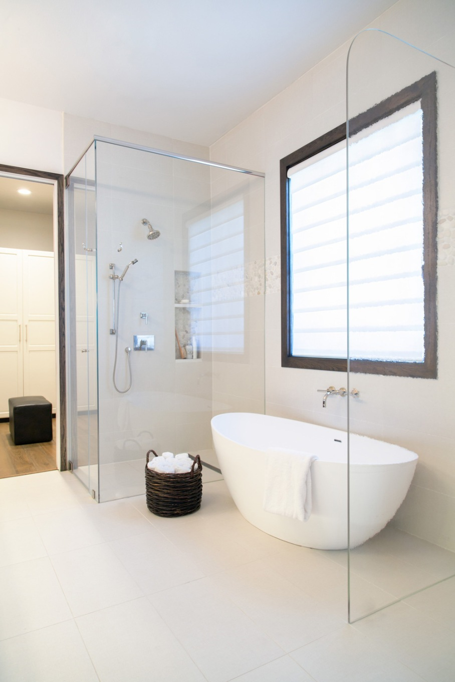 Master bathroom remodel; bathtub; shower; closet | Interior Designer: Carla Aston / Photographer: Tori Aston