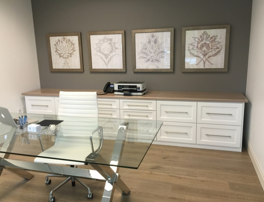 Feminine office remodel: Glass top desk; storage; framed art; Herman Miller high-back white leather chair | Interior Designer: Carla Aston