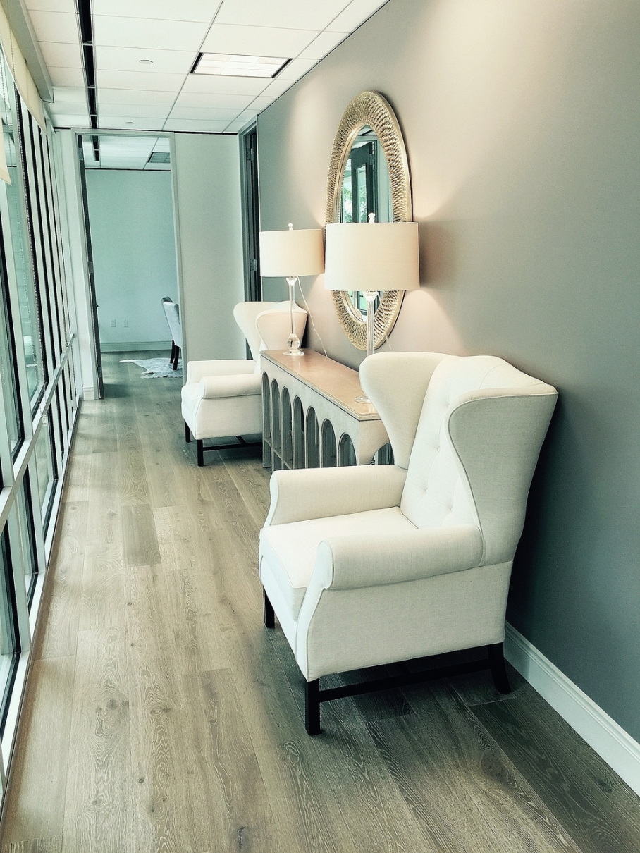 Feminine office remodel: white-washed oak floors; hallway; lamp; mirror | Interior Designer: Carla Aston