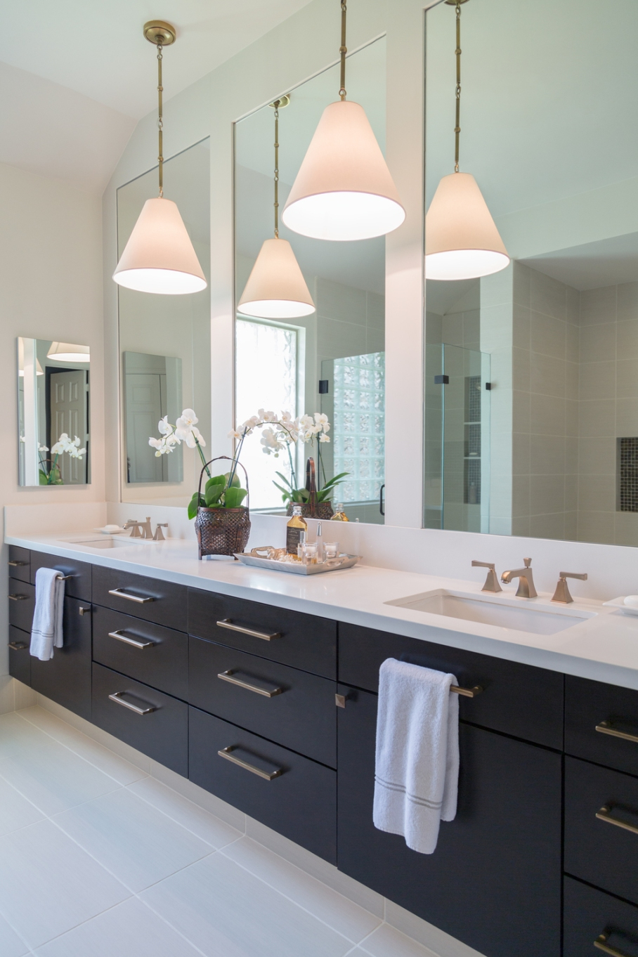 Bathroom remodel; vanity; cabinetry; mirror; decor; lighting; sink; fixture; flooring | Interior designer: Carla Aston / Photographer: Tori Aston