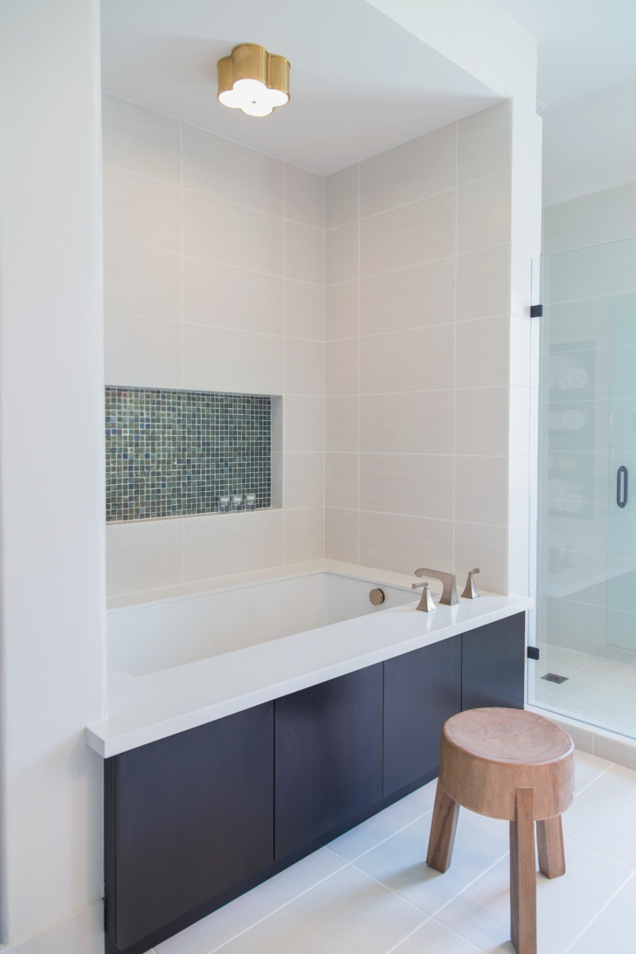 Bathroom remodel; bathtub; shower; tile; fixture; flooring | Interior designer: Carla Aston / Photographer: Tori Aston