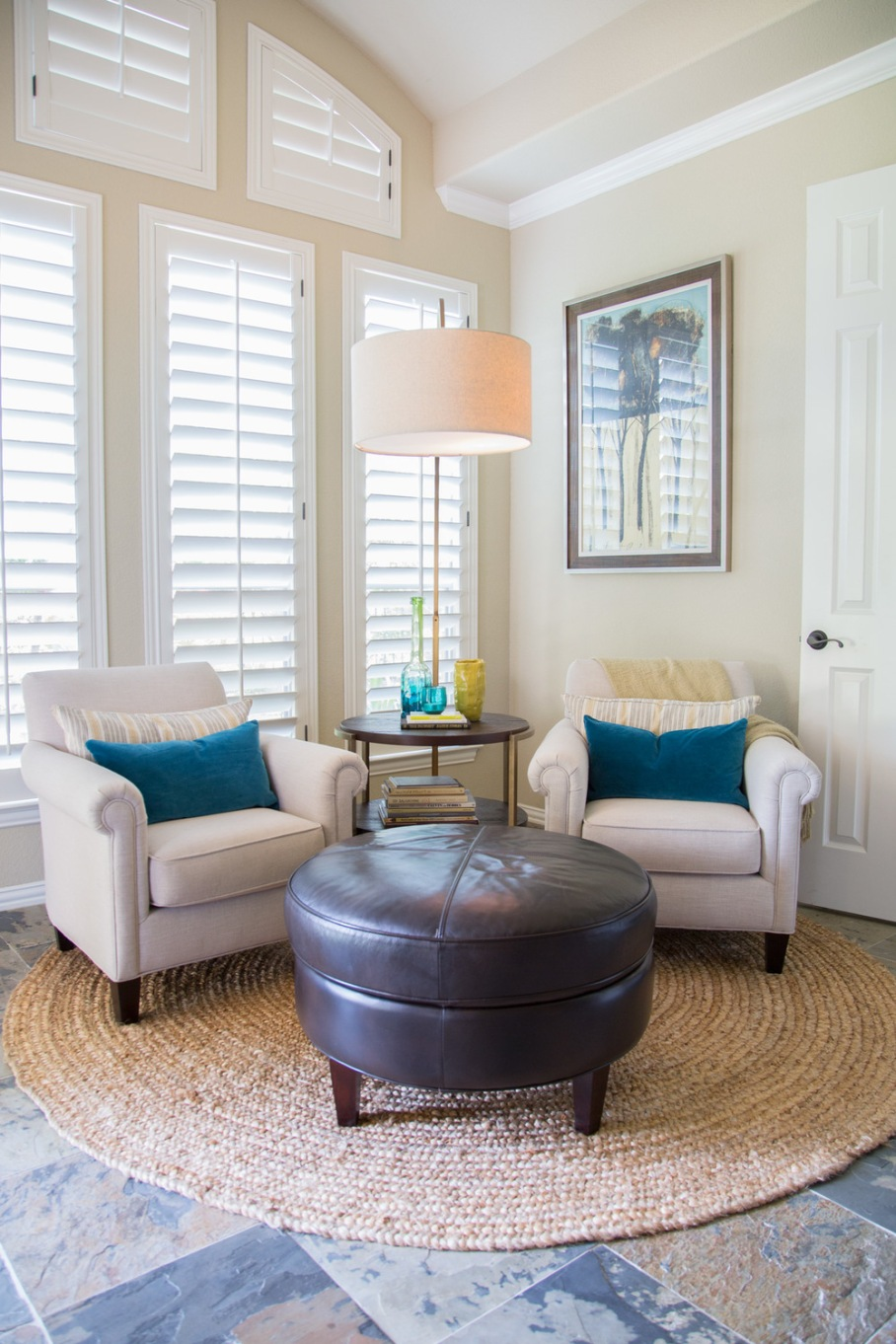 Sitting room remodel; rug; table; decor; chair; lamp / lighting | Interior Designer: Carla Aston / Photography by Tori Aston