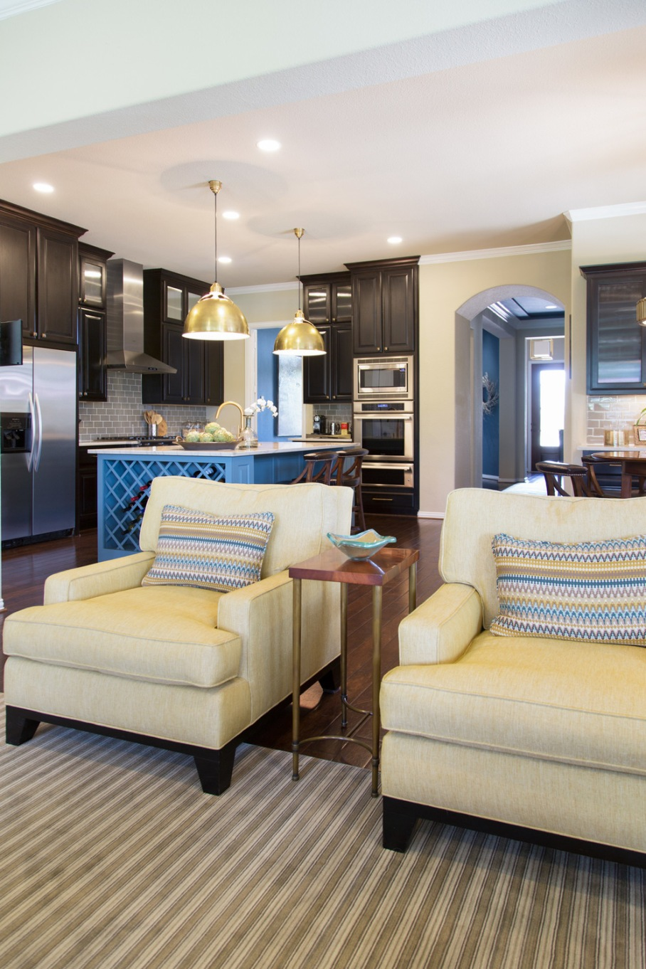 Kitchen / sitting room remodel; stove; cabinetry; countertop; chair; rug; refrigerator | Interior Designer: Carla Aston / Photography by Tori Aston