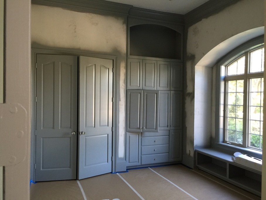 My room with cabinets and mouldings painted.jpg