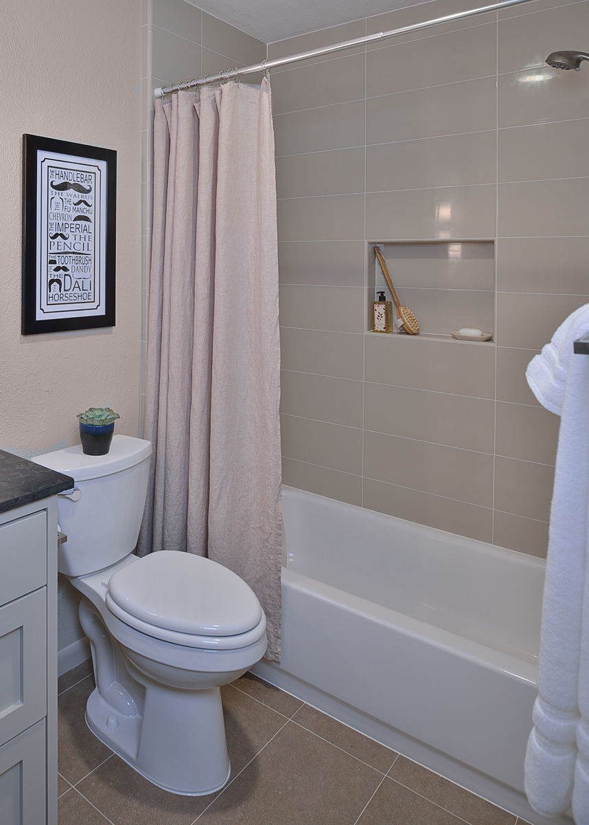SEE THE FULL REMODEL: Before & After: A Bachelor's Dated Bathroom Gets A Contemporary Refresh | Photographer: Miro Dvorscak